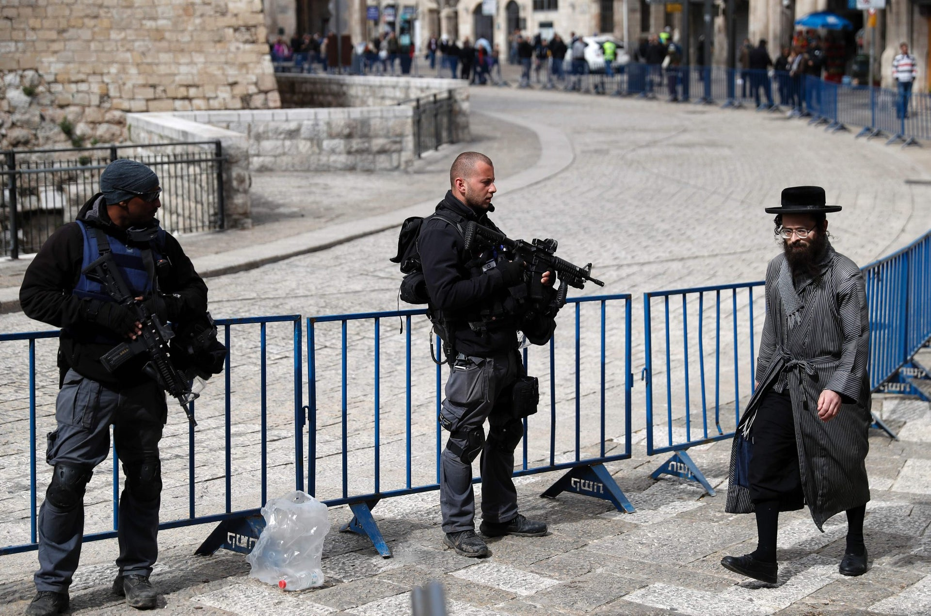 Israeli policemen secure a street at the Jaffa Gate in Jerusalem's Old City during the 6th Jerusalem's marathon, on March 18, 2016.