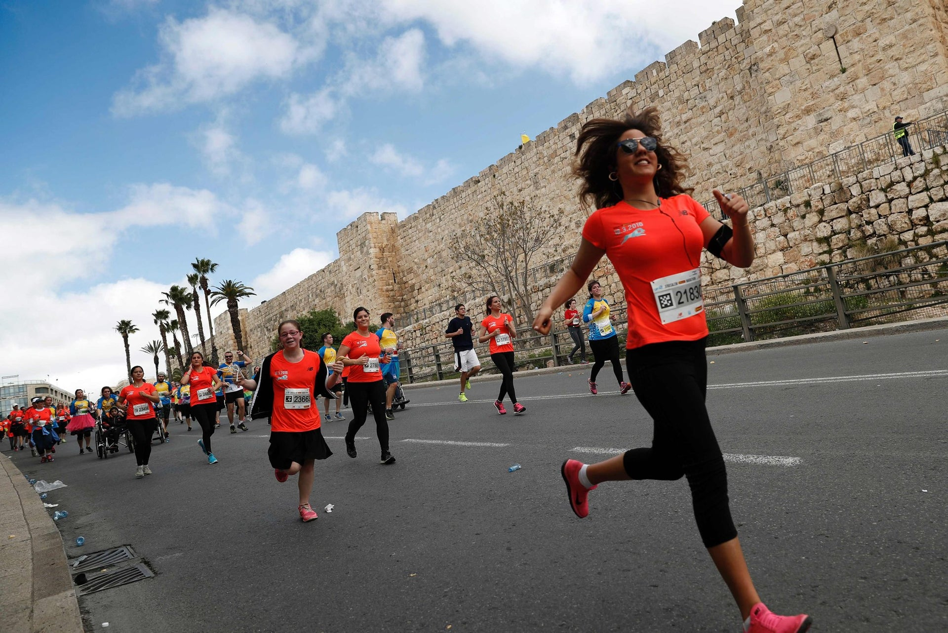 Competitors run along the Jerusalem's Old City ramparts during the 6th Jerusalem's marathon, on March 18, 2016.