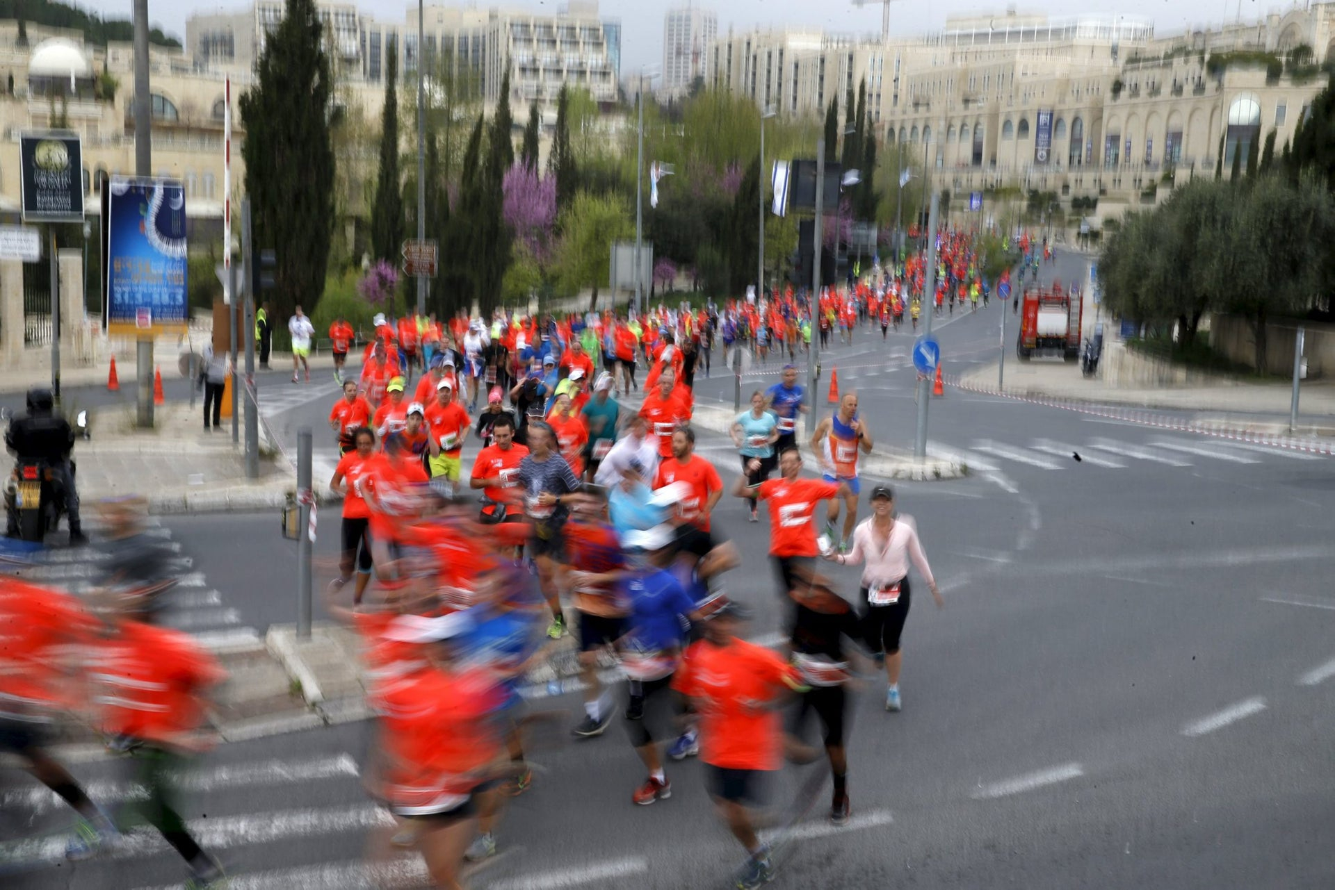 Athletes run outside Jerusalem's Old City as they participate in the sixth international Jerusalem Marathon March 18, 2016.
