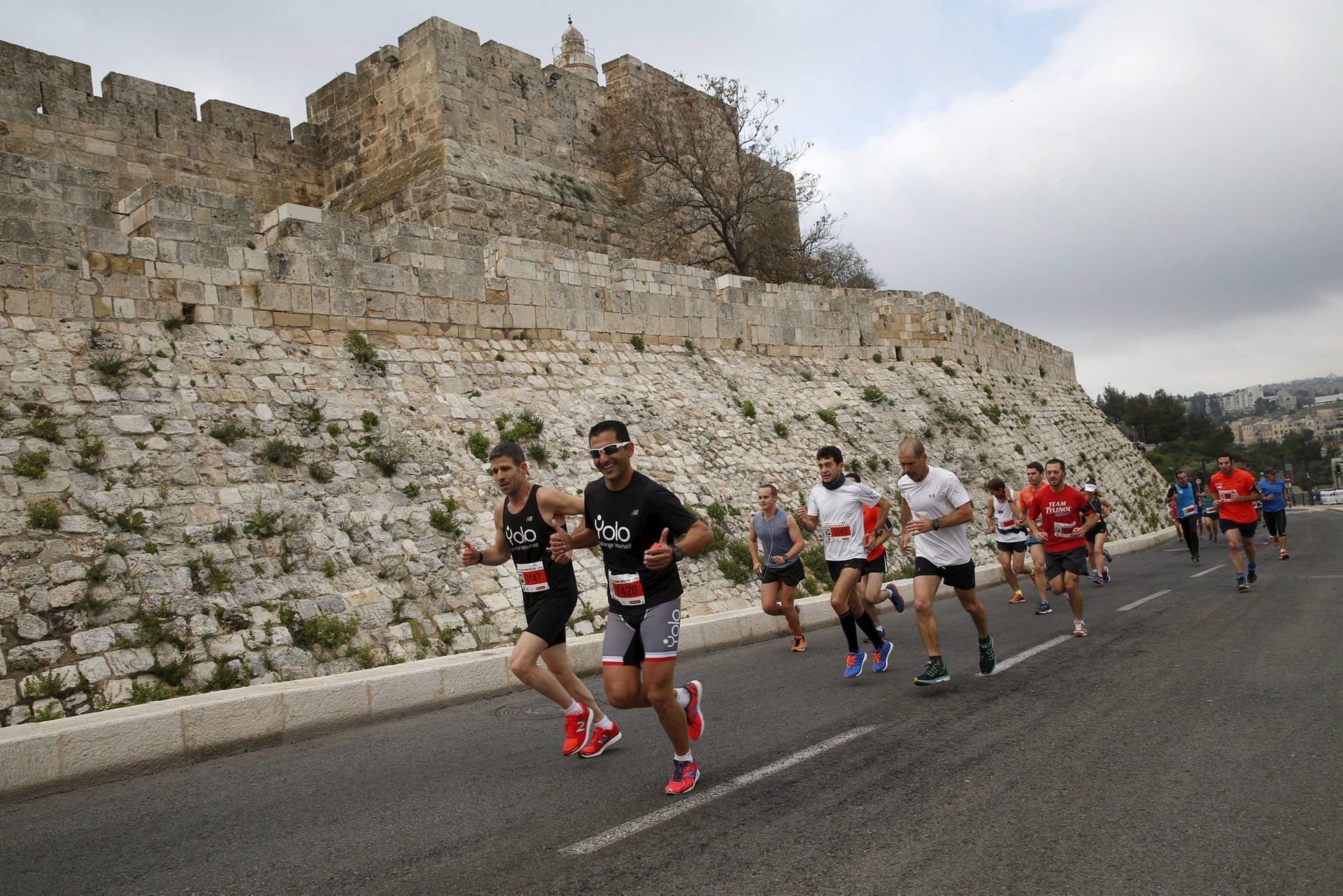 Athletes run outside Jerusalem's Old City as they participate in the sixth international Jerusalem Marathon. March 18, 2016.