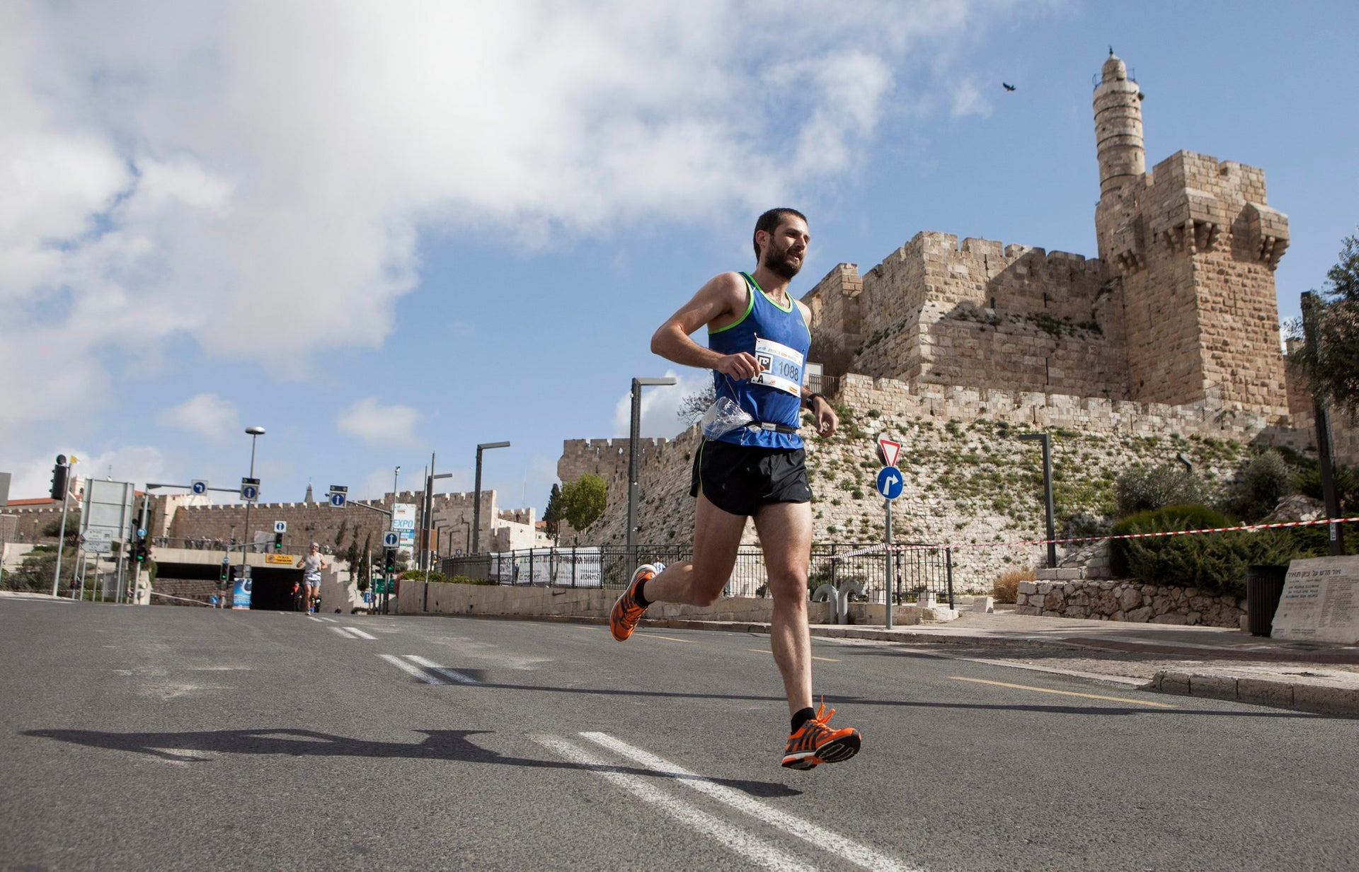 A runner passes the Tower of David in the Jerusalem Marathon, March 18, 2016.