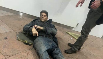 A man is wounded in Brussels Airport in Brussels, Belgium, after explosions were heard, March 22, 2016.