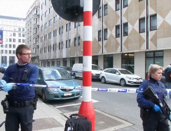 Emergency personnel are seen at the scene of a blast outside a metro station in Brussels, in this still image taken from video on March 22, 2016.