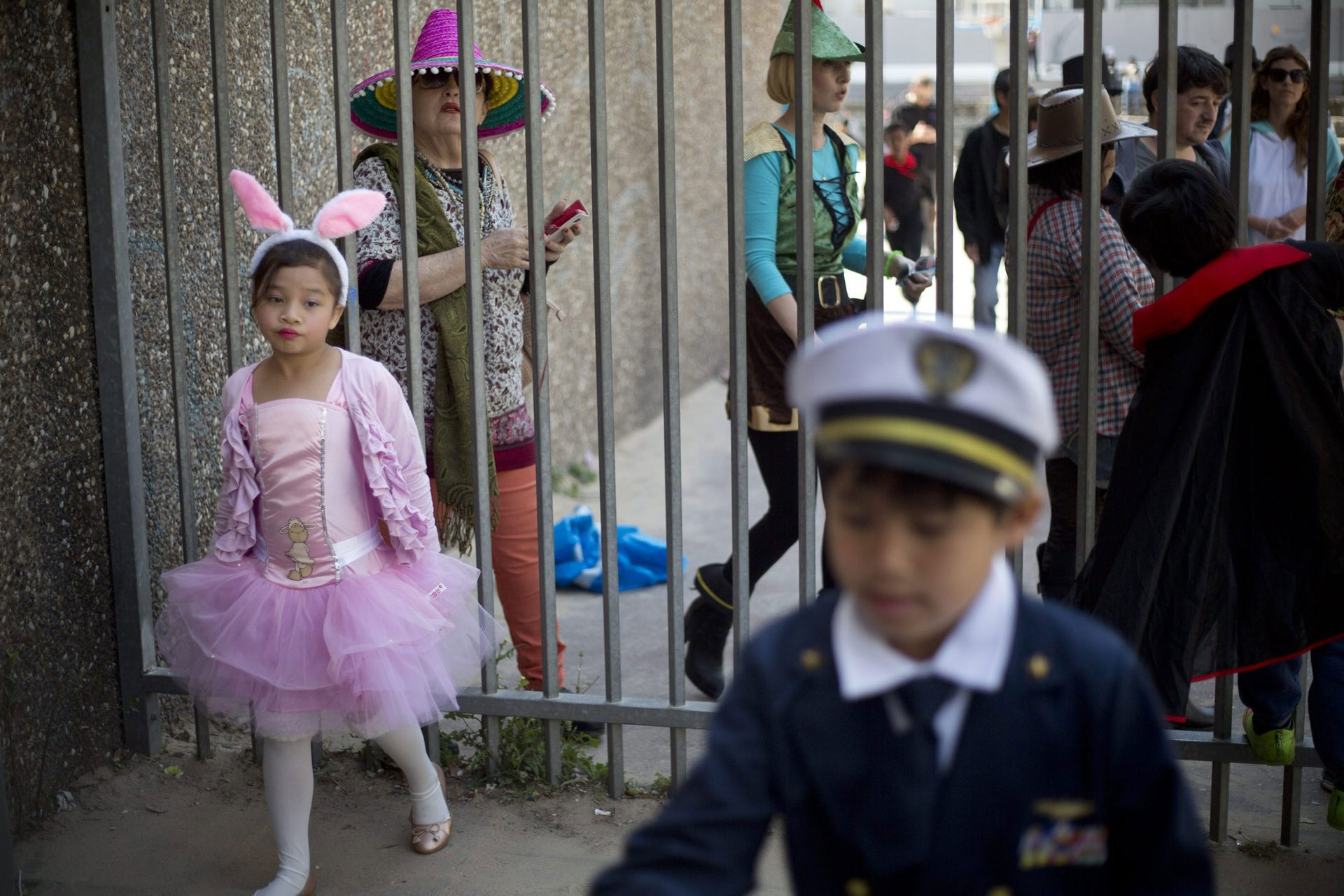 Foreign migrant workers children celebrate the Purim festival in Tel Aviv, Israel, Tuesday, March 22, 2016.