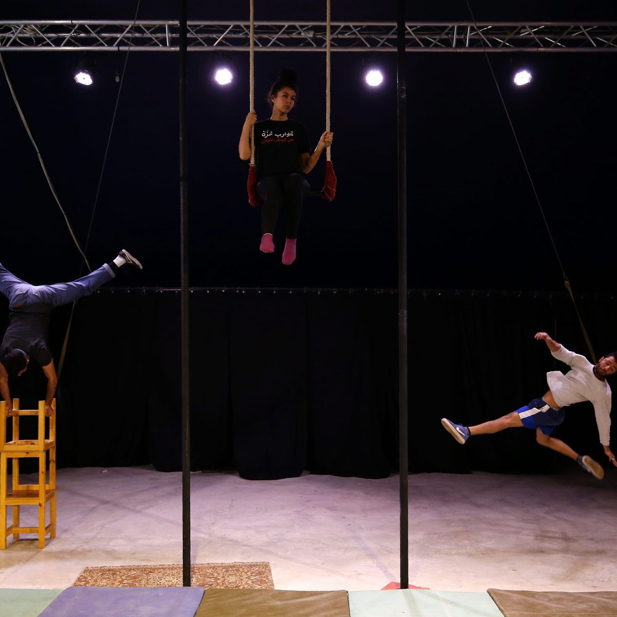 Young Palestinian train at the Palestinian Circus School in the village of Bir Zeit, in the Israeli occupied West Bank near Ramallah on March 22, 2016.