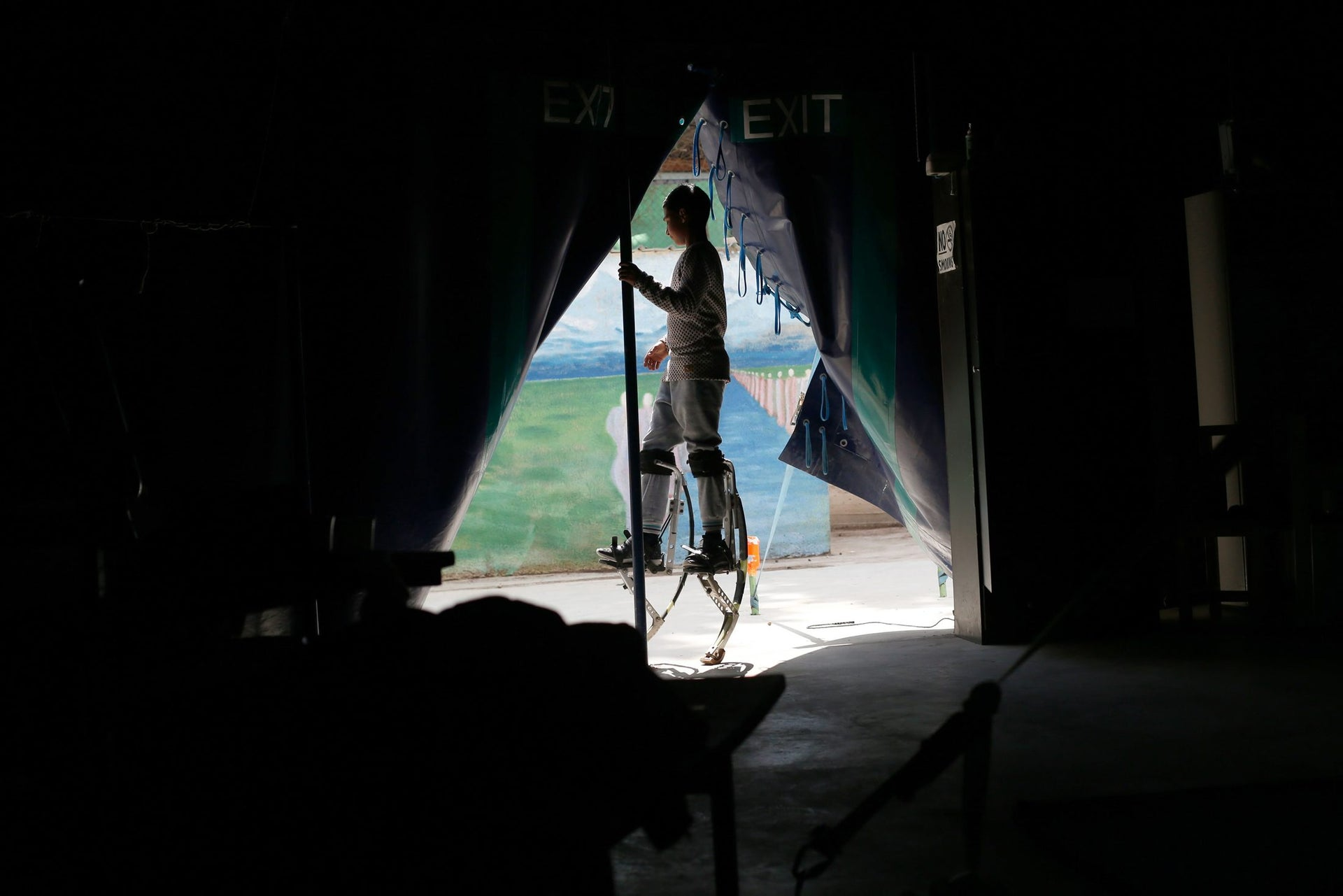 A Palestinian boy trains on long legs at the Palestinian Circus School in the village of Bir Zeit, near Ramallah on March 21, 2016.