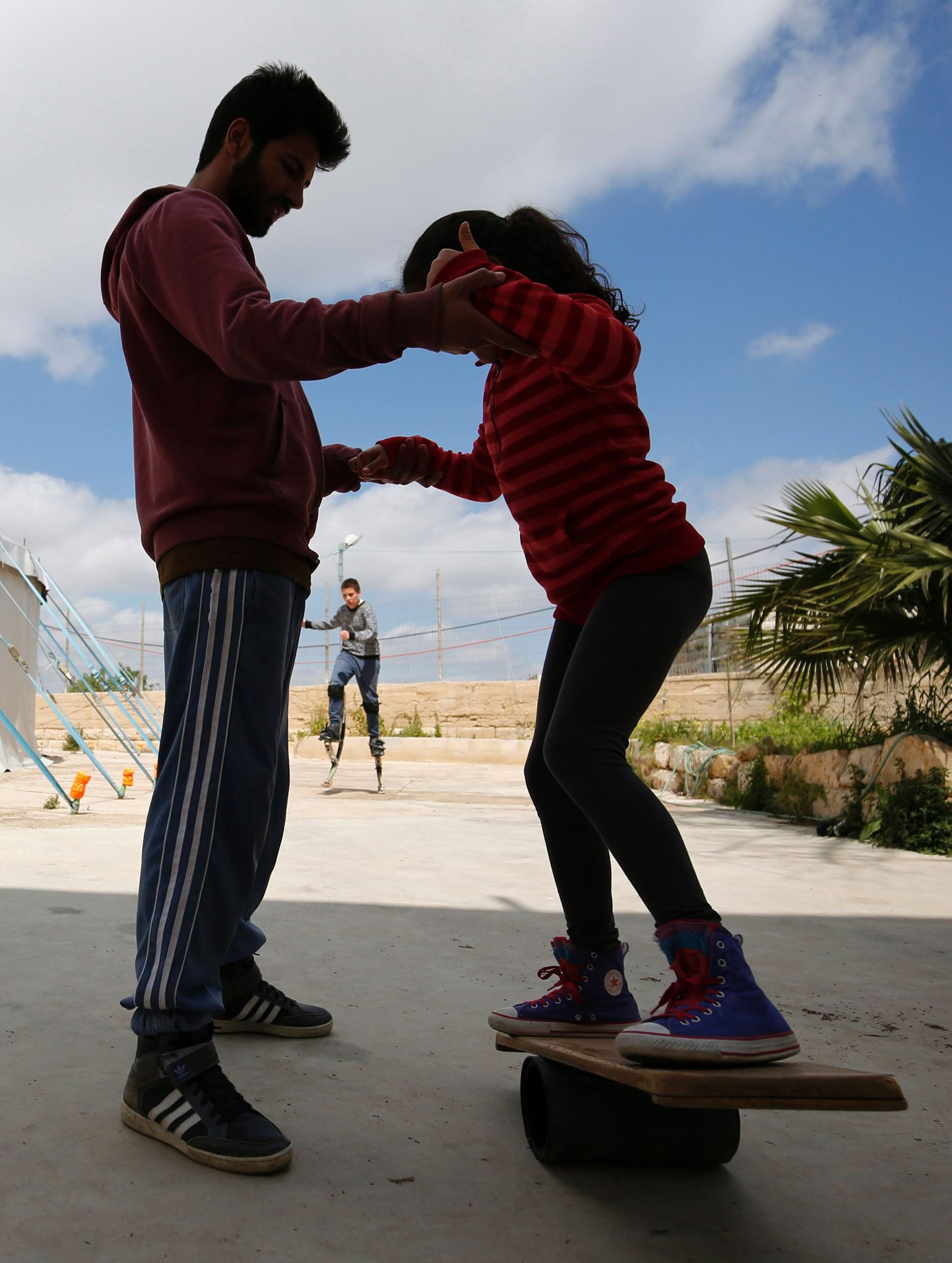 A young Palestinian trains on a trapeze at the Palestinian Circus School in the village of Bir Zeit, near Ramallah on March 22, 2016.