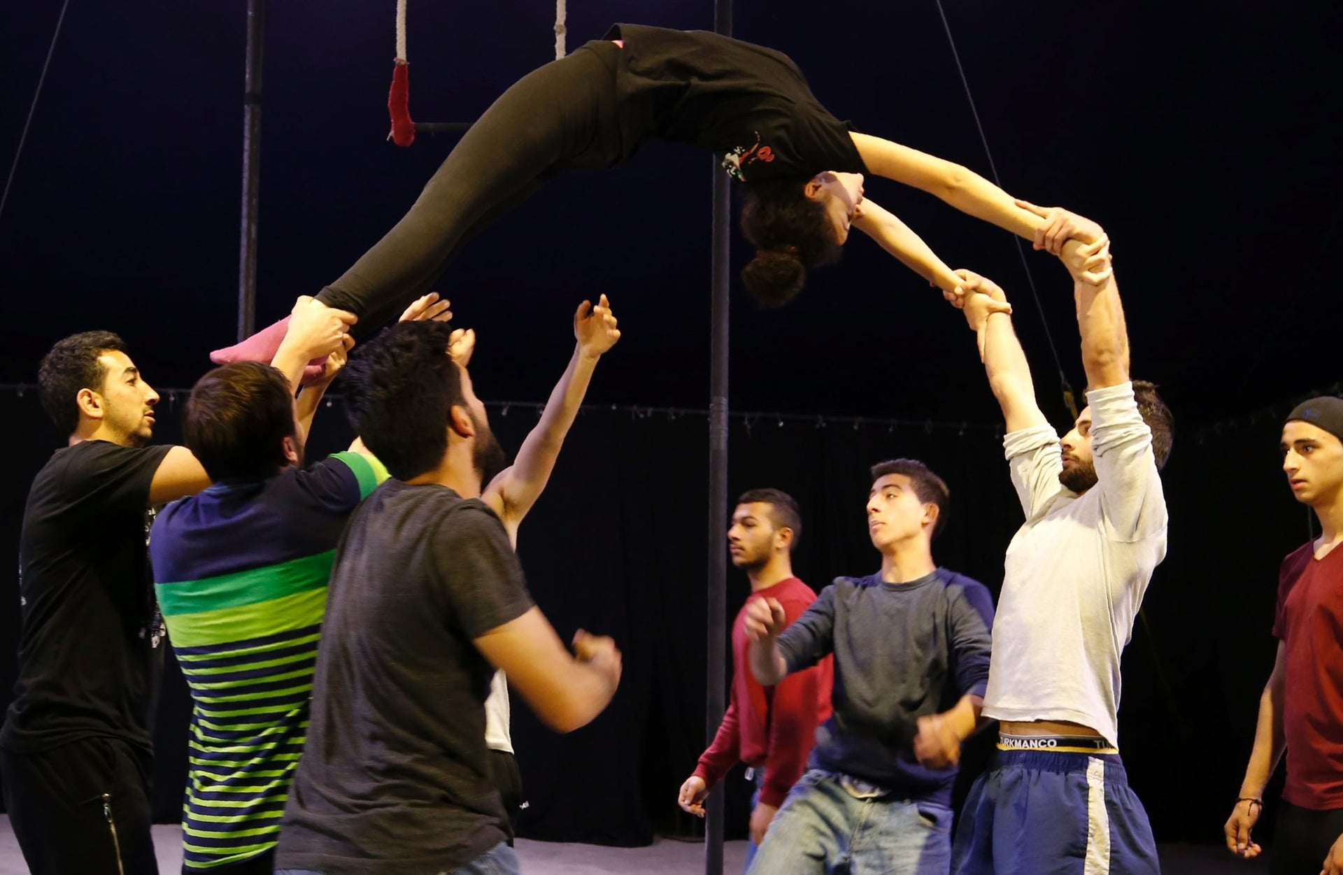 Young Palestinians train at the Palestinian Circus School in the village of Bir Zeit, near Ramallah on March 22, 2016.