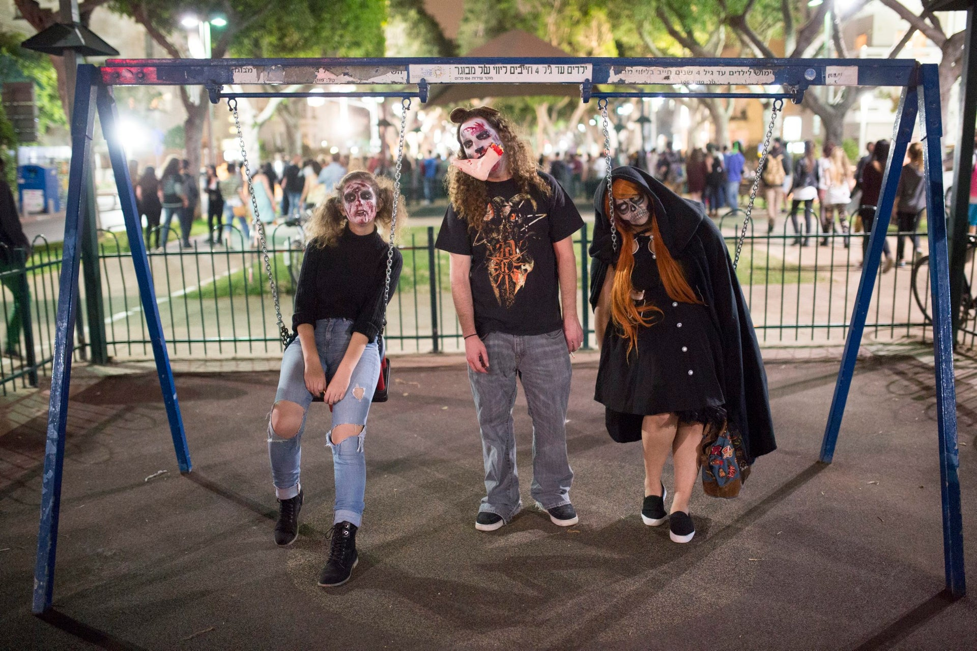 People wear zombie make-up and outfits walk in the 2016 Zombie Walk Day Edition in Tel Aviv, March 25, 2016.