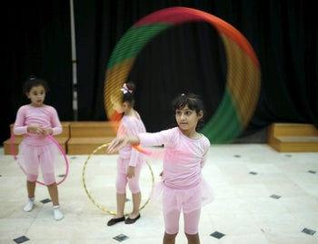 Girls with ballet hoops in a dancing course, run by the Al-Qattan Center for Children, Gaza City, November 25, 2015.