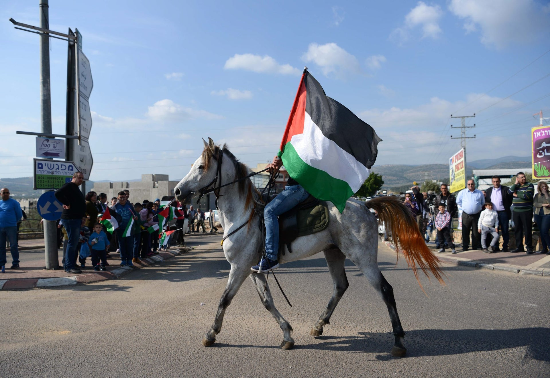 A man on a horse with a Palestinian flag participates in a march marking Land Day in the village of Arabeh, March 30, 2016.