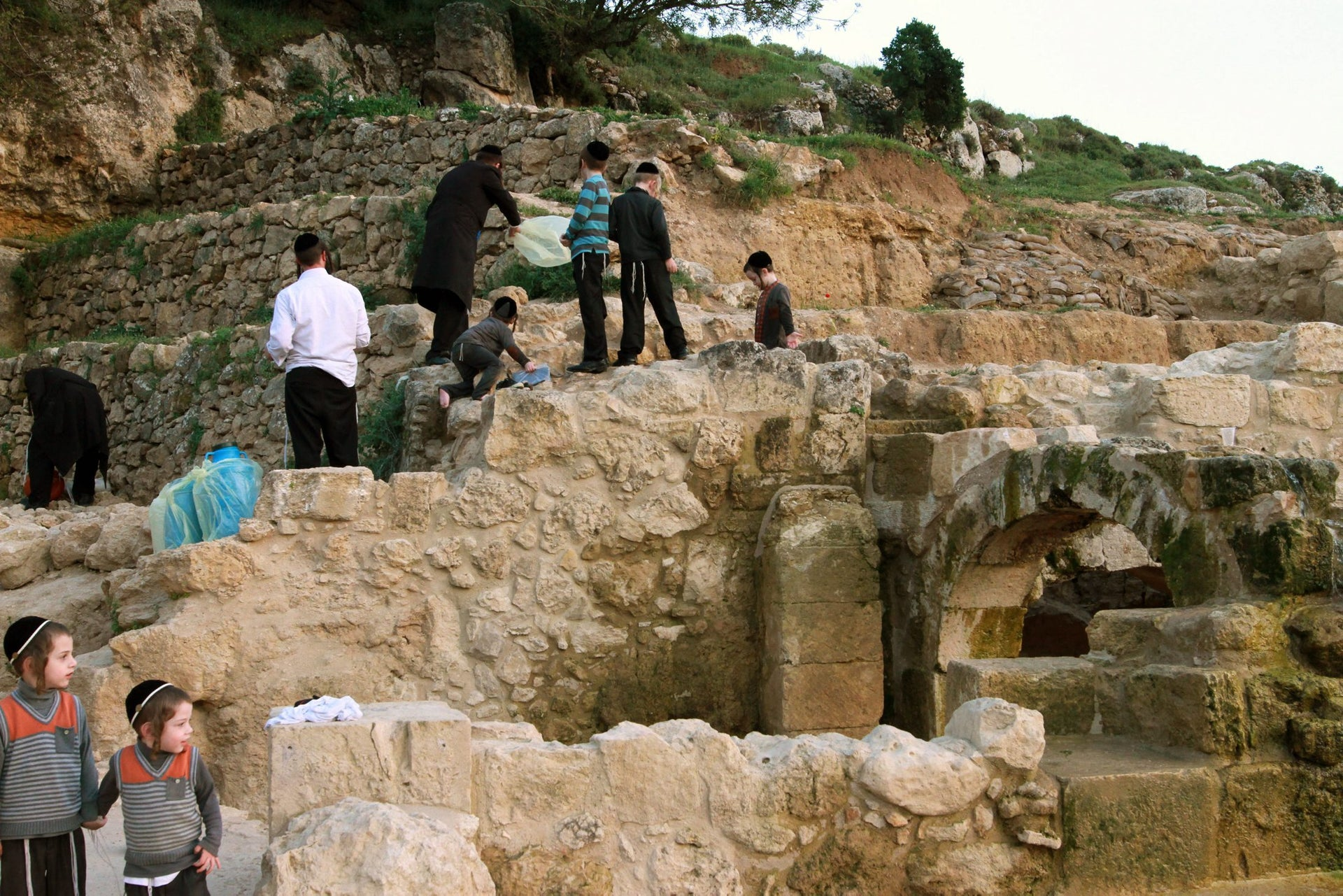 Ultra-Orthodox Jews drawing water from a natural spring for making 'shmura matza' in the Jerusalem Hills, April 4, 2016.