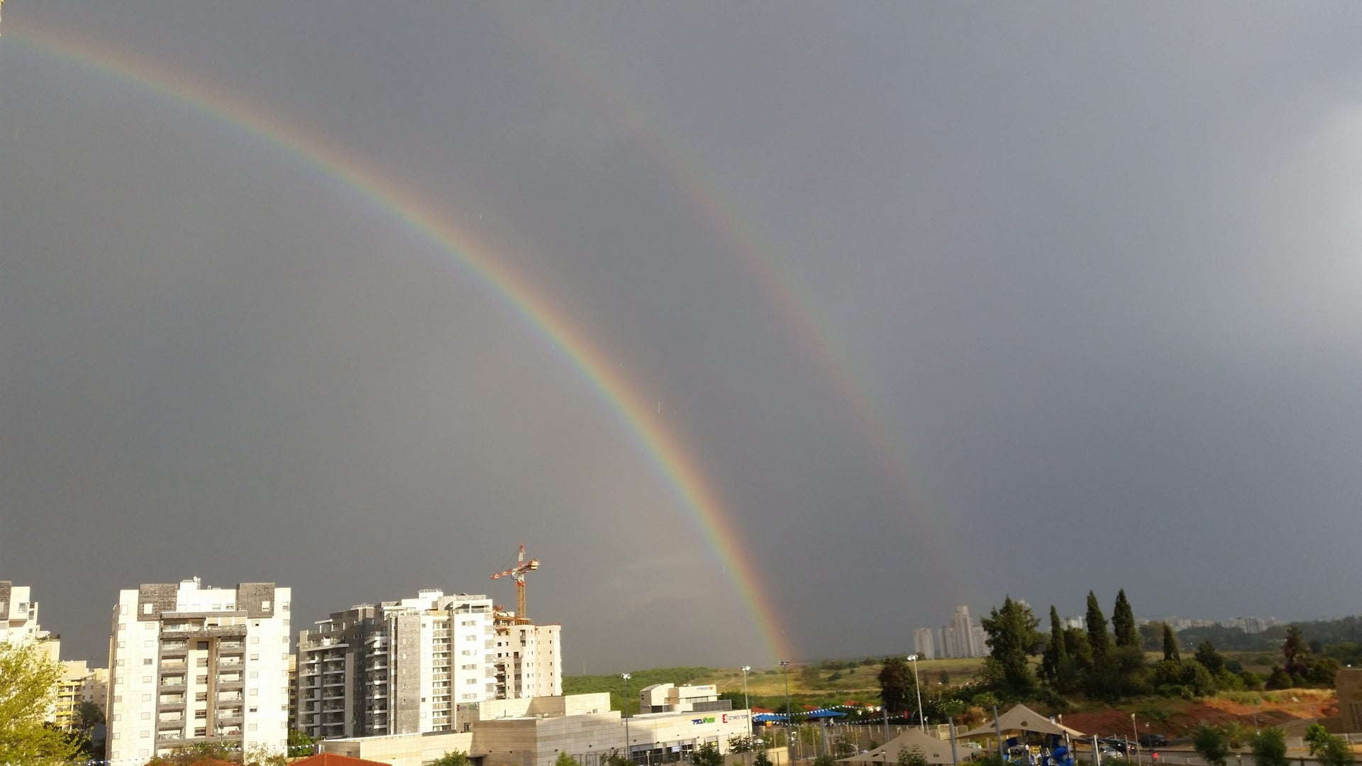 A rainbow is seen over Ness Ziona, April 13, 2016.