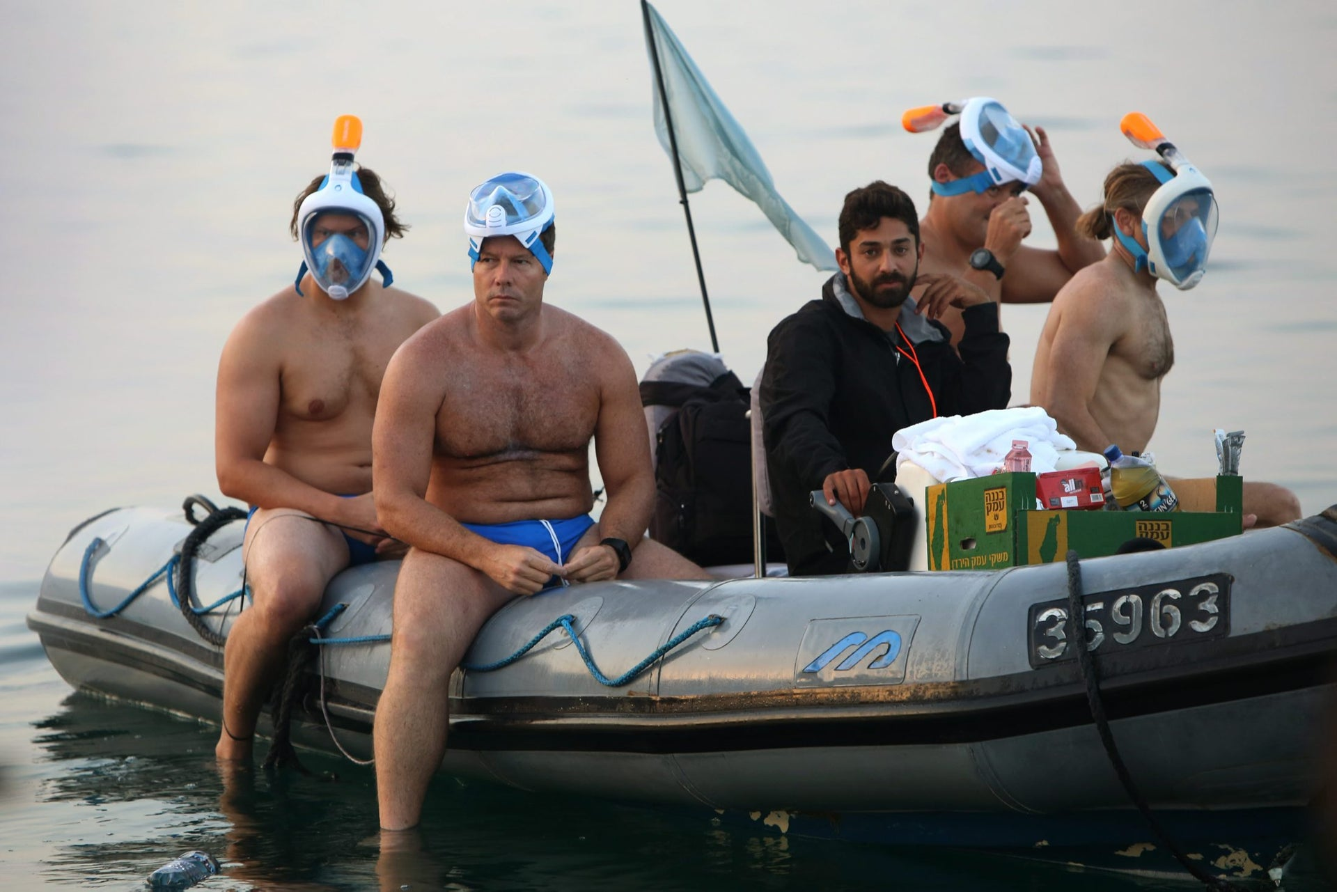 Participants taking part in a 16 kilometers swim from Jordan to Israel across the Dead Sea, organised by the EcoPeace charity aimed at raising awareness for the iconic water body which has been receding by roughly a metre each year, gives the thumbs up upon the departure from Jordan on November 15, 2016. The 27 extreme swimmers from across the world, equipped with special masks due to the water's high salinity, took seven hours to make the crossing, organisers said. The distance is only 18 kilometres and the mineral-rich lake was calm, but the high amount of salt in the water makes it nearly impossible to swim normally.