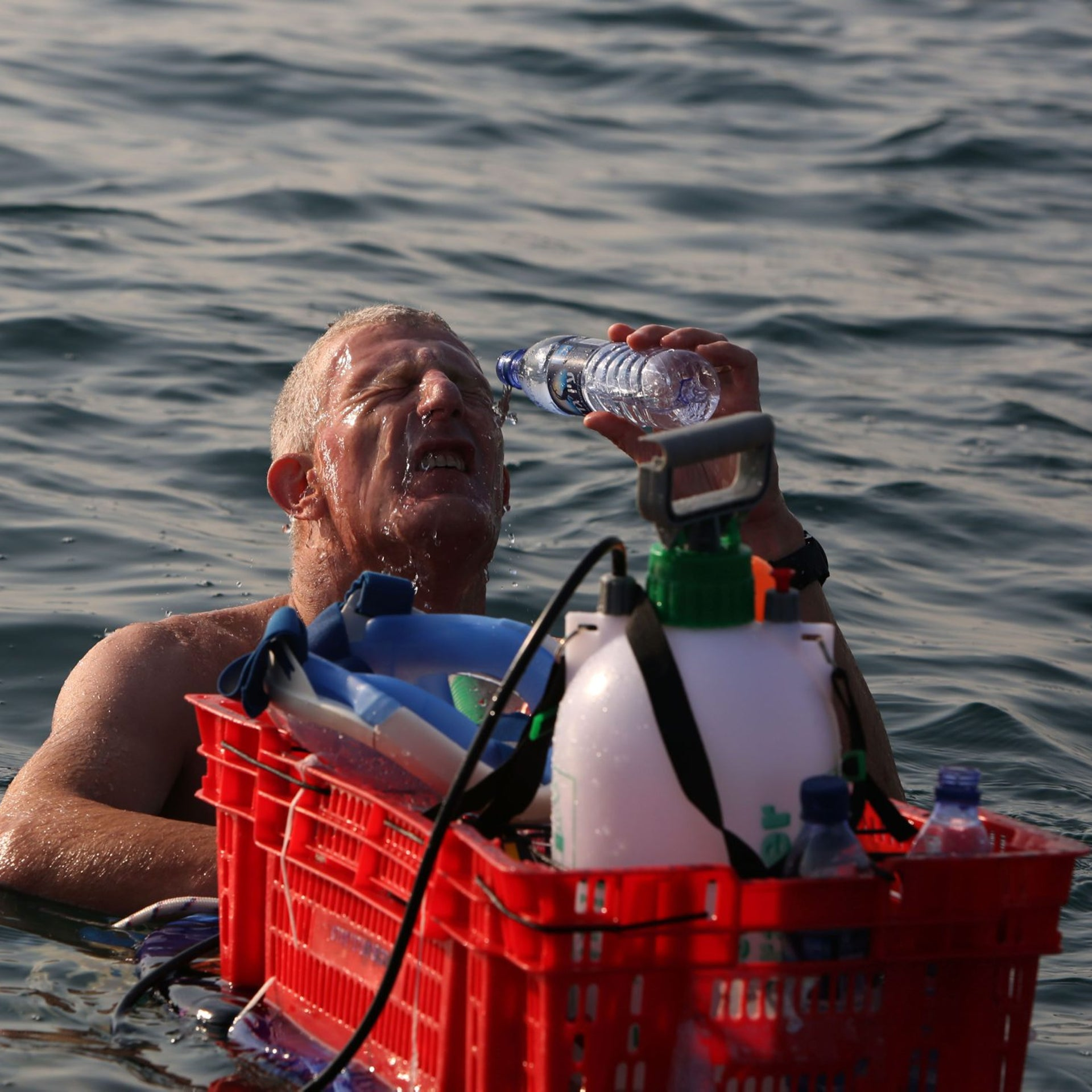 A participant washes the salty water off his face during a 16 kilometers swim from Jordan to Israel across the Dead Sea, organised by the EcoPeace charity aimed at raising awareness for the iconic water body which has been receding by roughly a metre each year, on November 15, 2016. The 27 extreme swimmers from across the world, equipped with special masks due to the water's high salinity, took seven hours to make the crossing, organisers said. The distance is only 18 kilometres and the mineral-rich lake was calm, but the high amount of salt in the water makes it nearly impossible to swim normally.