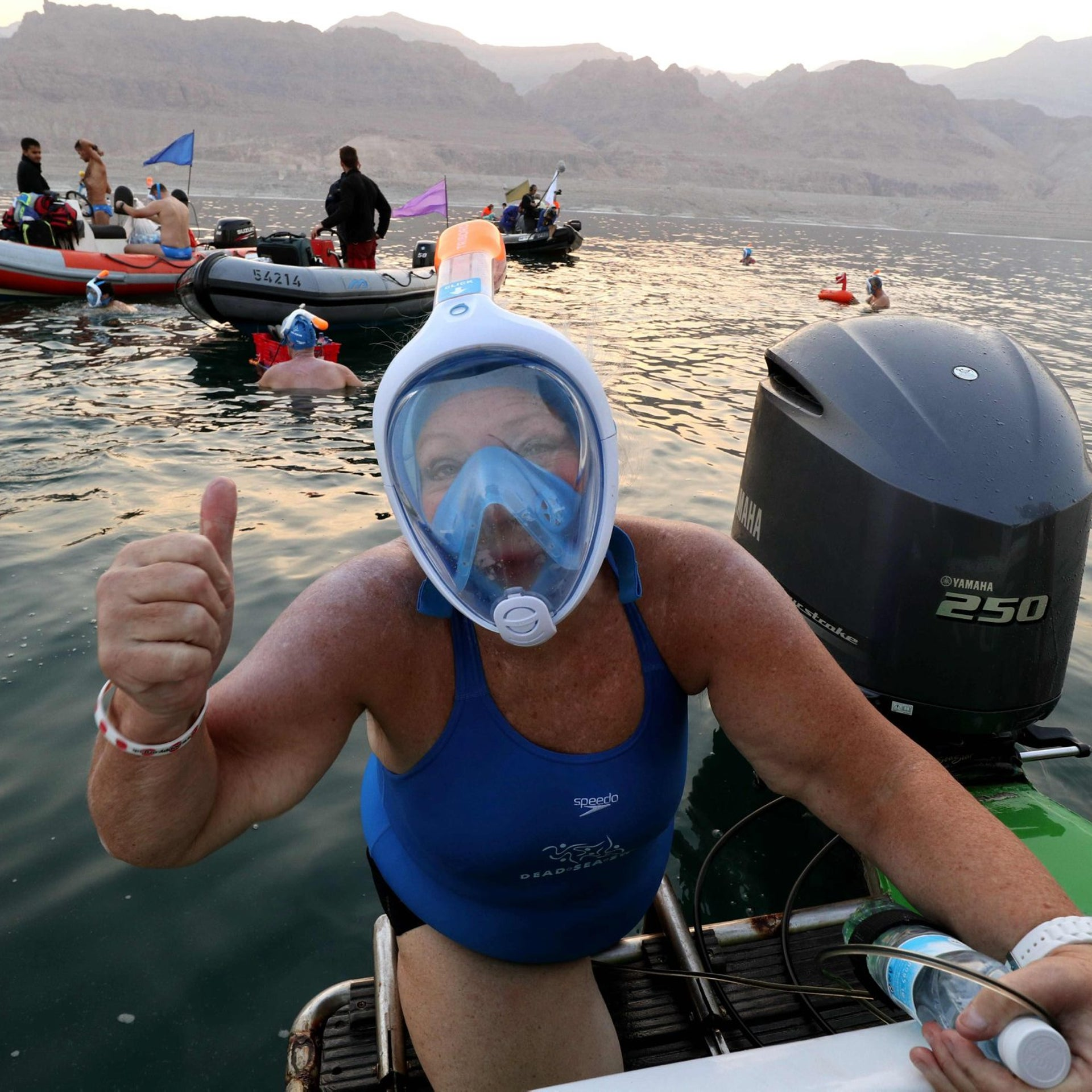 A woman taking part in a 16 kilometers  swim from Jordan to Israel across the Dead Sea, organised by the EcoPeace charity aimed at raising awareness for the iconic water body which has been receding by roughly a metre each year, gives the thumbs up upon the departure from Jordan on November 15, 2016. The 27 extreme swimmers from across the world, equipped with special masks due to the water's high salinity, took seven hours to make the crossing, organisers said. The distance is only 18 kilometres and the mineral-rich lake was calm, but the high amount of salt in the water makes it nearly impossible to swim normally.