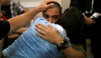 IDF soldier Elor Azaria is embraced at the military court, Jaffa, Israel, April 18, 2016.