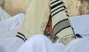 Jewish men of the Cohanim caste participate in a blessing during Passover at the Western Wall, Jerusalem, April 25, 2016.