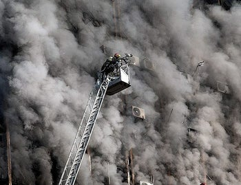 Firefighters battle a blaze that engulfed Iran's oldest high-rise, the 15-storey Plasco building in downtown Tehran on January 19, 2017