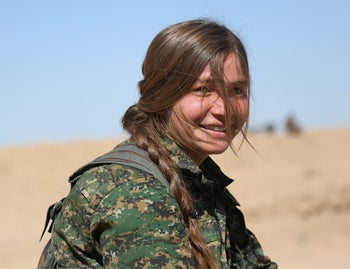 A Syrian Democratic Forces (SDF) female fighter poses in northern Deir al-Zor province, Syria February 21, 2017.