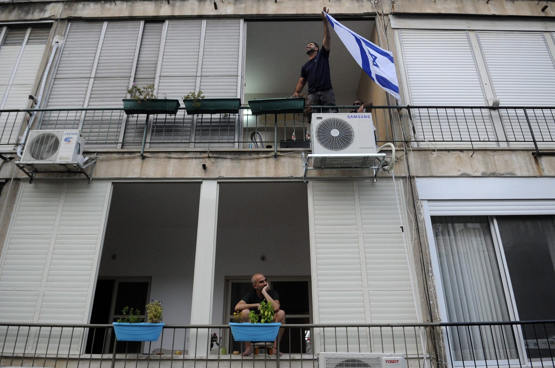 Haifa residents watch a demonstration in support of the organization Breaking the Silence.