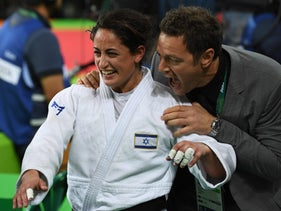 Israel's Yarden Gerbi celebrates after defeating Japan's Miku Tashiro during their women's -63kg judo contest bronze medal A match of the Rio 2016 Olympic Games in Rio de Janeiro on August 9, 2016.
