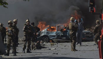 Afghan security forces personnel are seen at the site of a car bomb attack in Kabul on May 31, 2017.