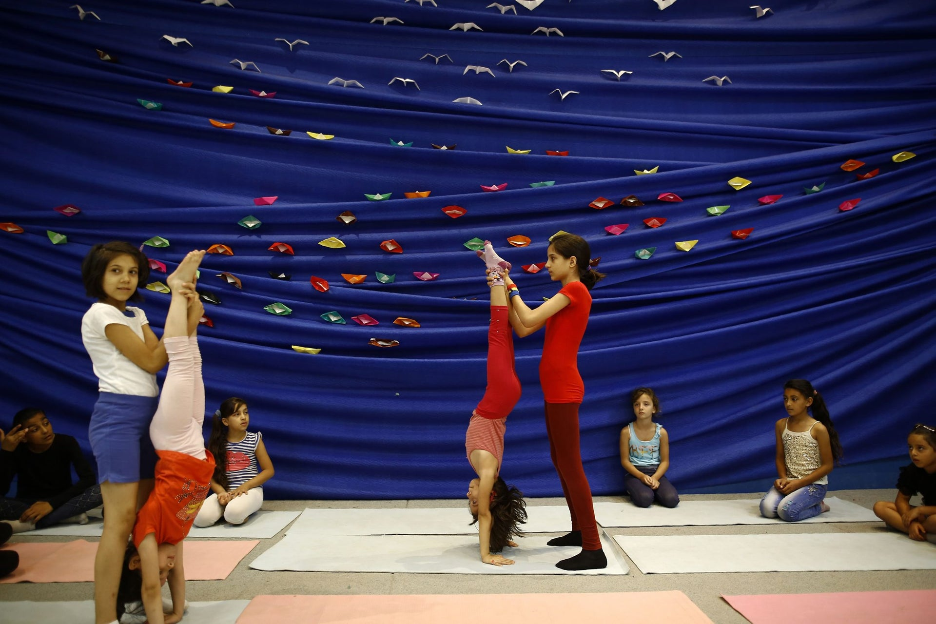 Palestinian girls take part in an acrobatics class on August 16, 2016 at the al-Qattan Cultural Center for Children in Gaza City.