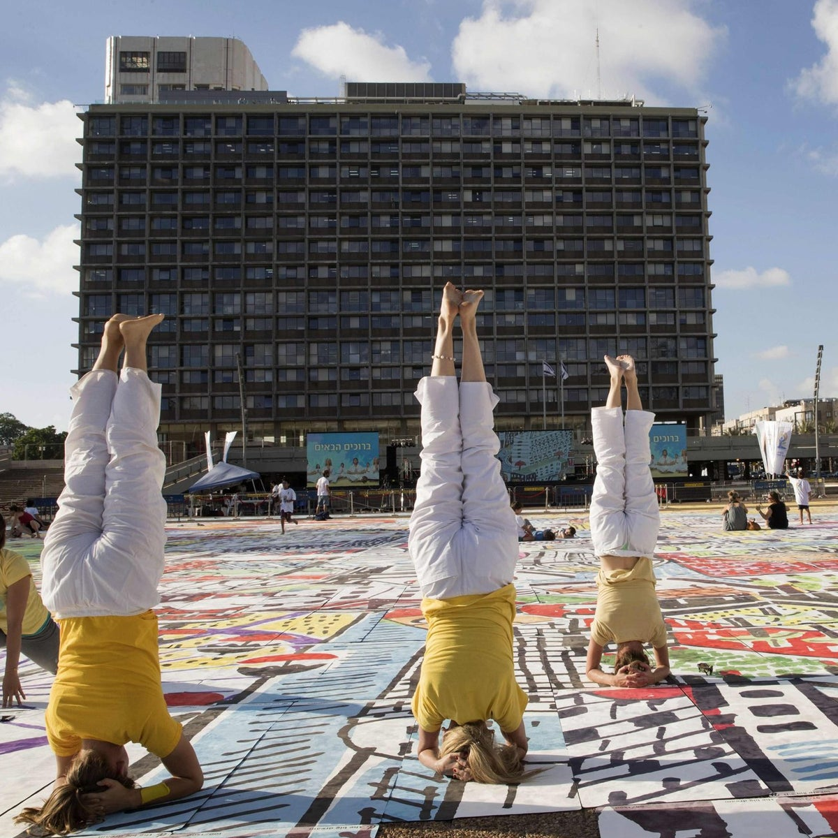 People practise yoga on the occasion of the International Yoga Day in Tel Aviv on June 21, 2017.