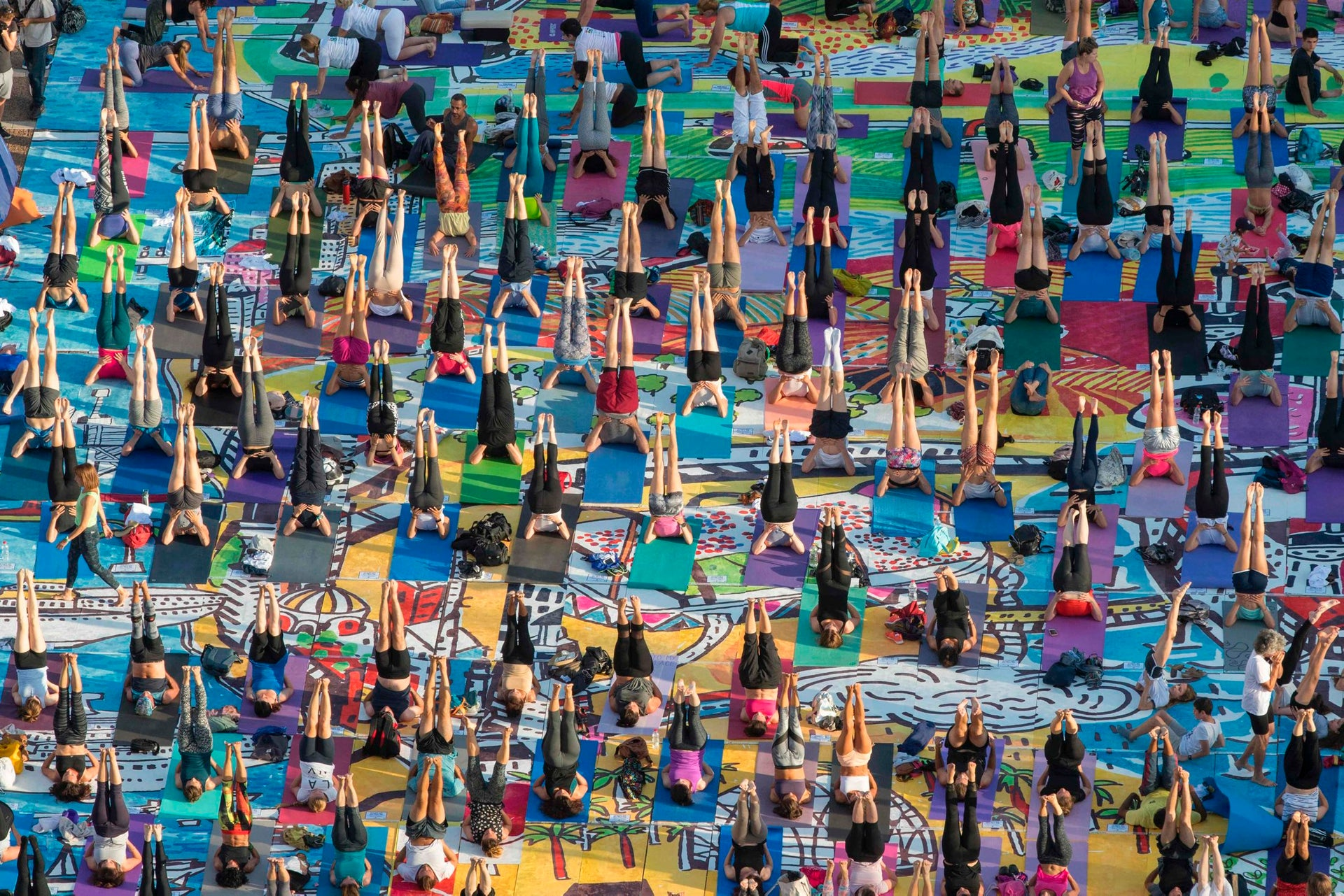 Hundreds of people practise yoga on the occasion of the International Yoga Day in Tel Aviv on June 21, 2017.