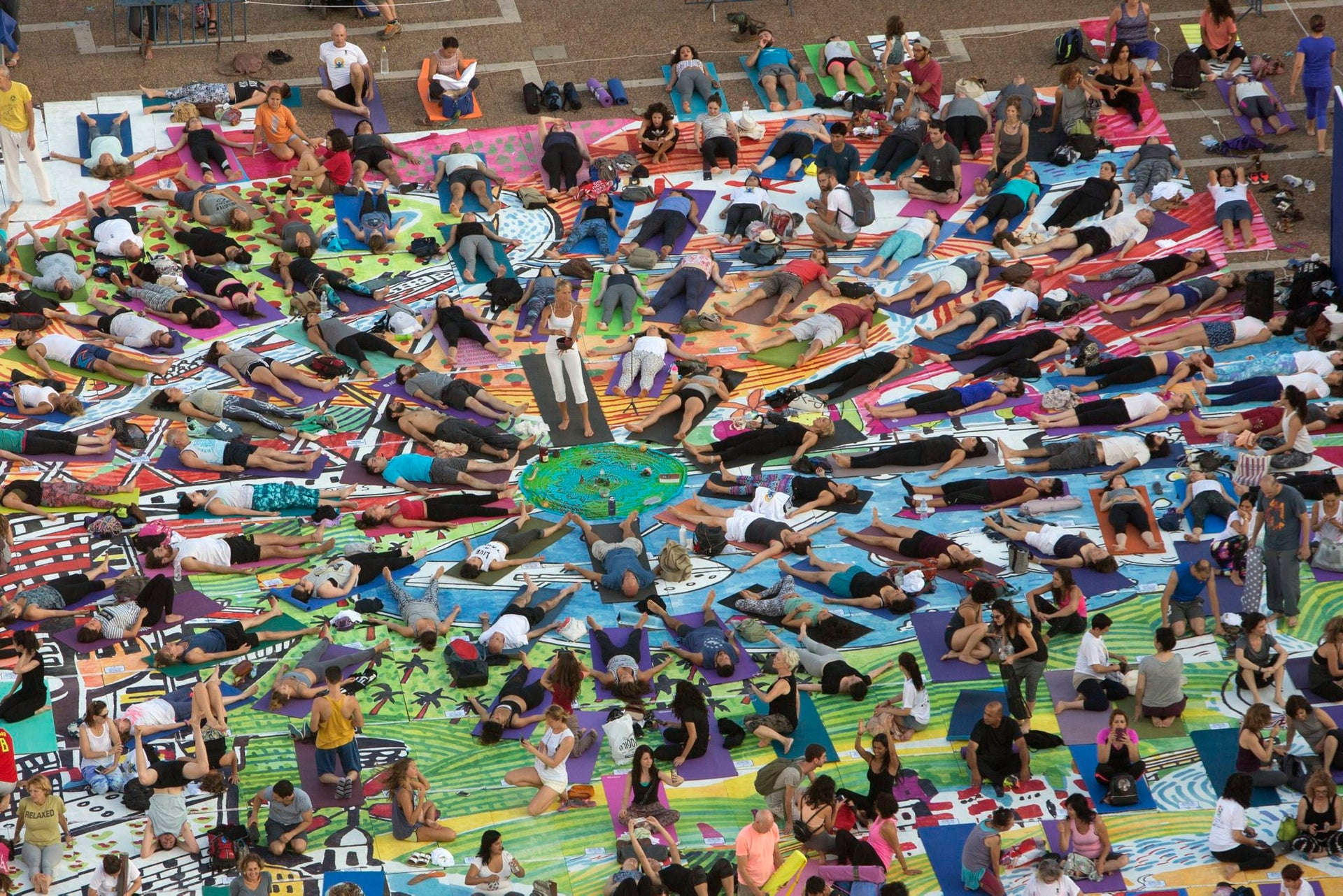 Israelis practice yoga during the International Yoga Day at the Rabin square in Tel Aviv, Israel, Wednesday, June 21, 2017.