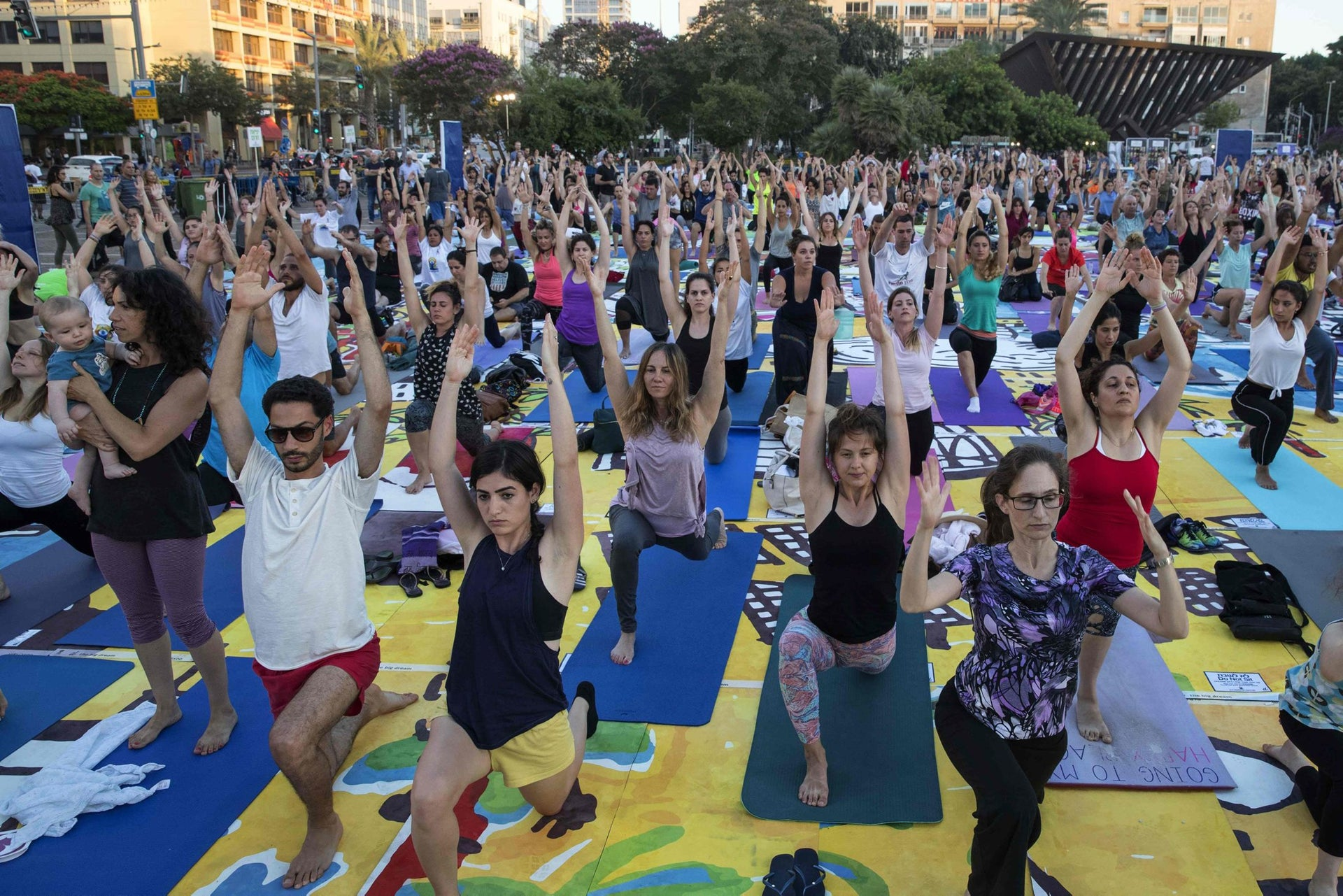 Hundreds of people practise yoga on the occasion of the International Yoga Day in the Israeli coastal city of Tel Aviv on June 21, 2017.