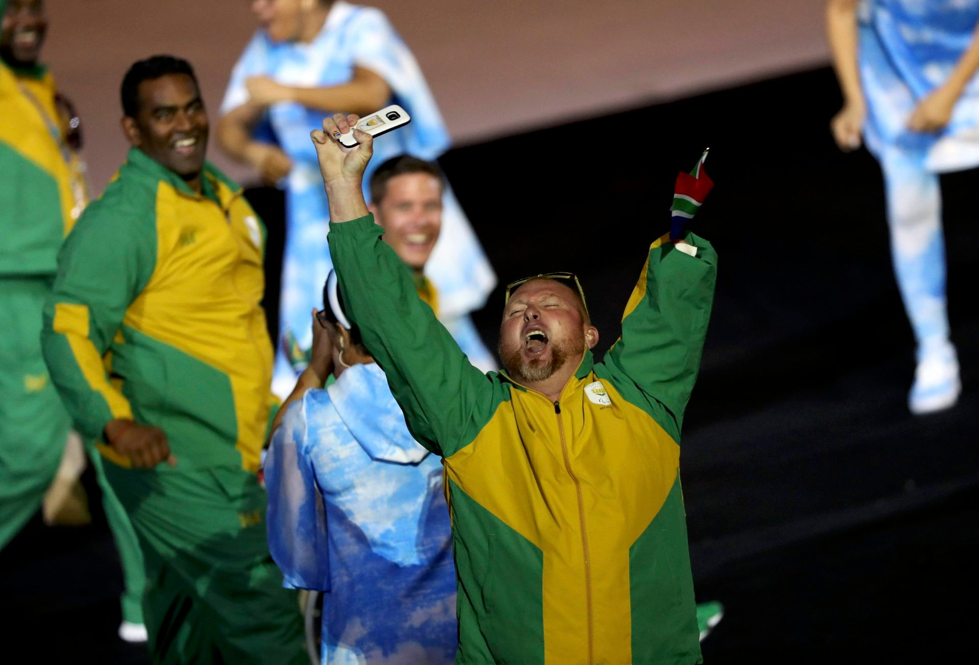 2016 Rio Paralympics - Opening ceremony - Maracana - Rio de Janeiro, Brazil - 07/09/2016. South African athletes cheer as they take part in the opening ceremony.