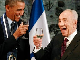 U.S. President Barack Obama toasts with former President Shimon Peres during an official state dinner in Jerusalem, Israel, March 21, 2013.