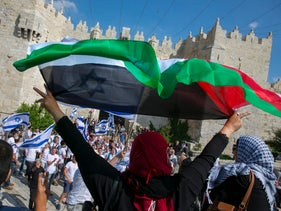 A crowd of people celebrating Jerusalem Day is met with protesters at the Old City's Damascus Gate, May 24, 2017.