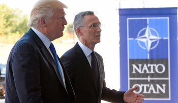 NATO Secretary General Jens Stoltenberg welcomes Trump upon his arrival for the NATO summit in Brussels, on May 25, 2017.