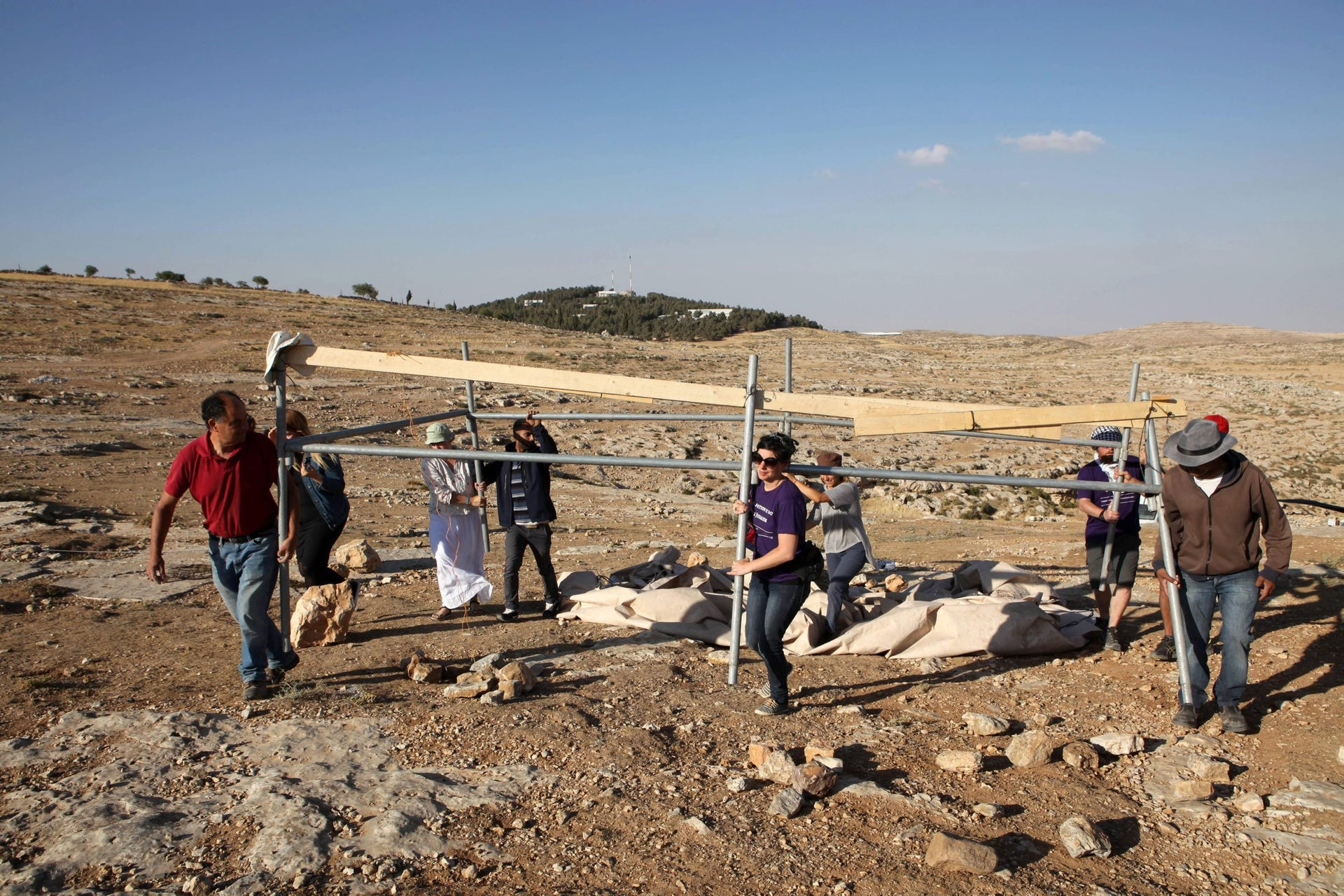 Activists reerecting a tent at the Sumud Freedom Camp in the West Bank, May 25, 2017.