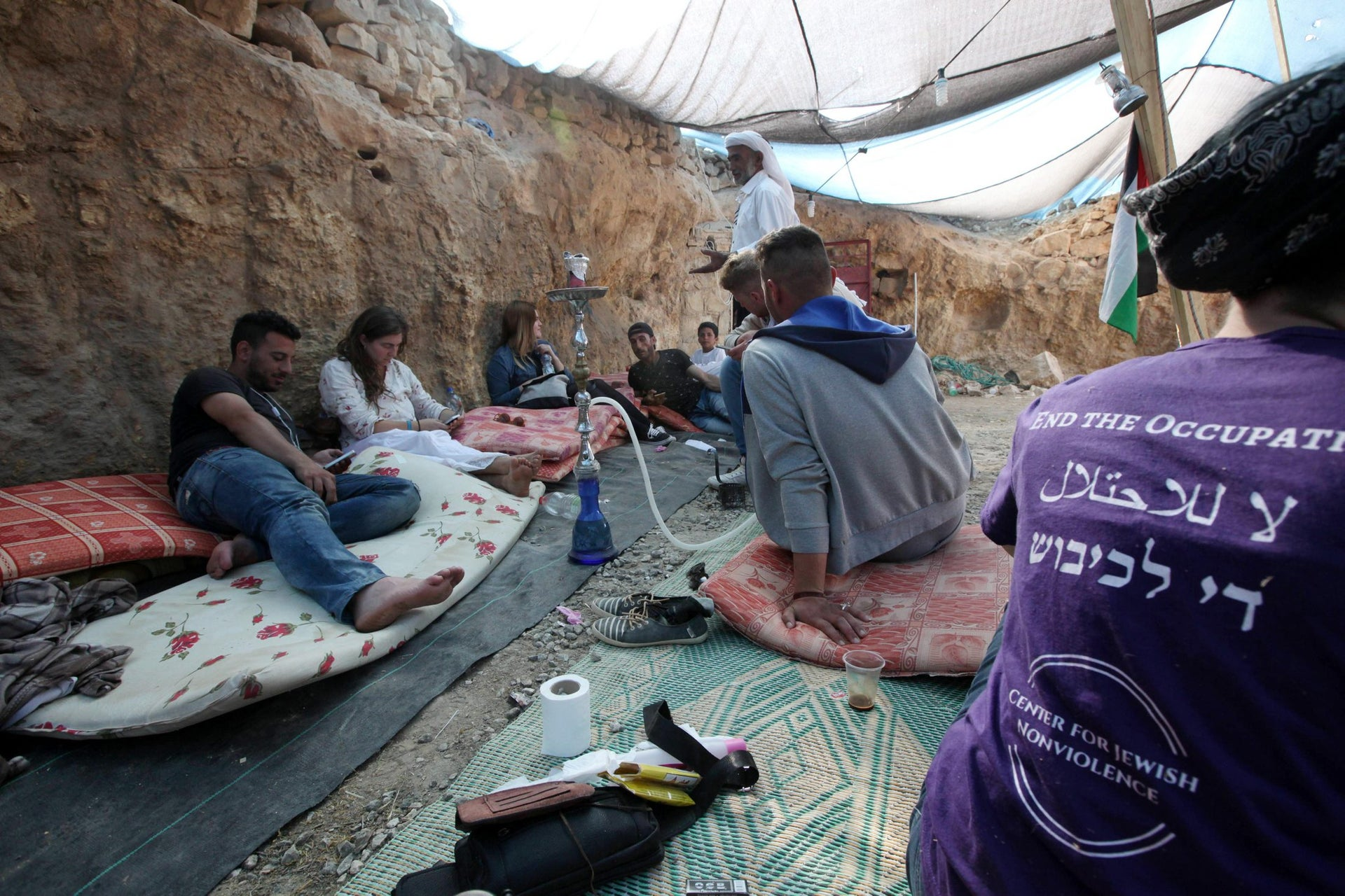 Activists relaxing at the Sumud Freedom Camp with Fadel Amer, May 25, 2017.