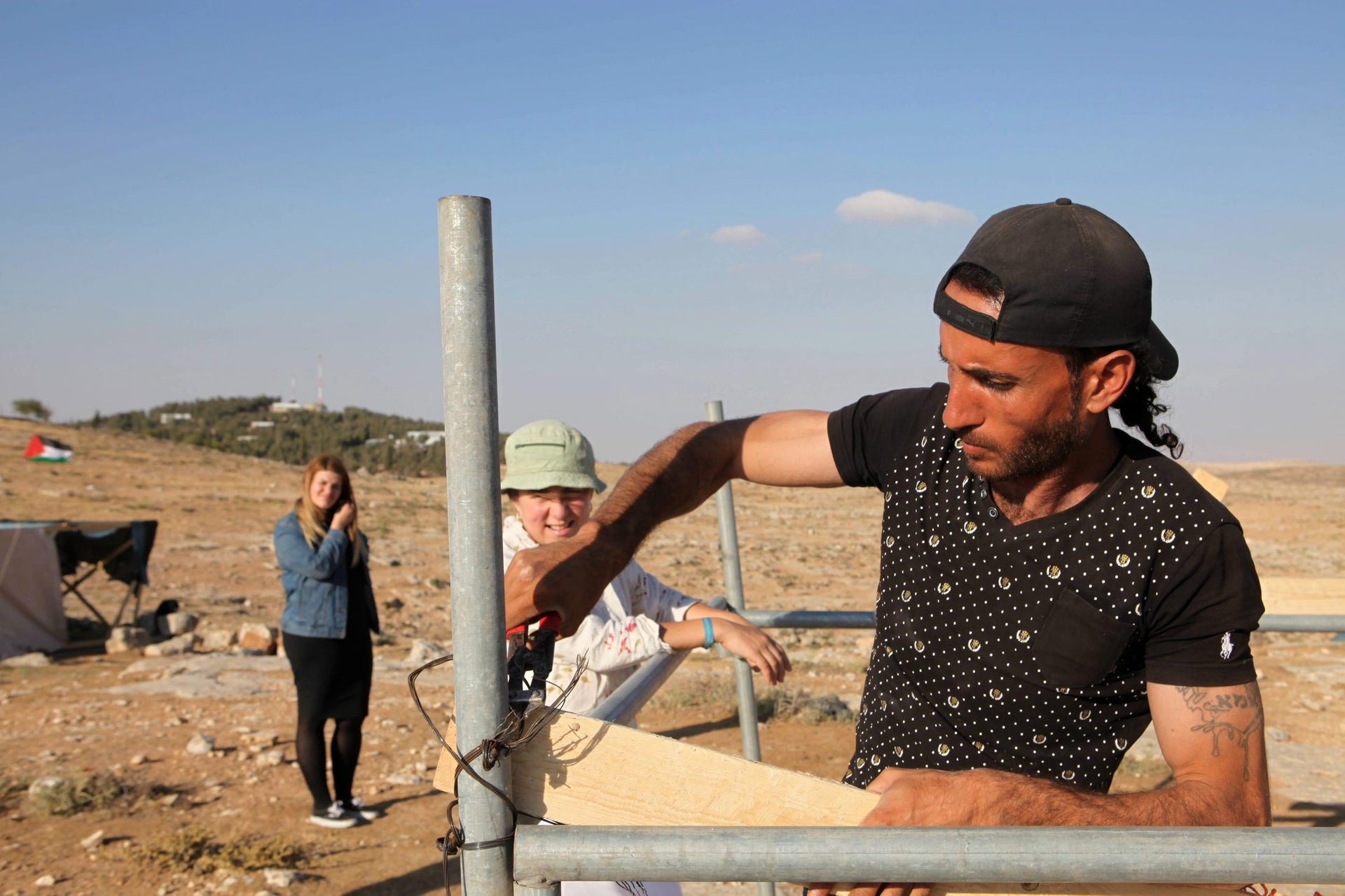 Reerecting a tent at the Sumud Freedom Camp in the West Bank, May 25, 2017.