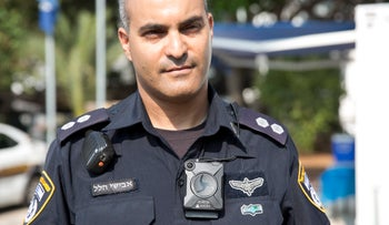 An Israeli police officer wearing a body camera at the launch of the pilot program, August 2016.