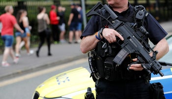 An armed policeman is seen outside the Lancashire County Cricket Club, Emirates Old Trafford, in Manchester, Britain May 27, 2017.