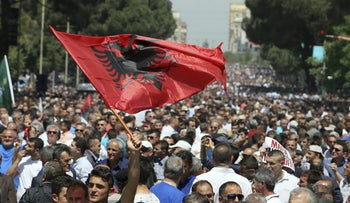 Supporters of Albania's main opposition take part in a protest demanding a caretaker cabinet to take the country to the June 18 parliamentary election, on Saturday, May 13, 2017.
