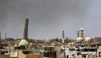 A general view shows the leaning minaret of the al-Nouri Mosque in the Old City of Mosul during the ongoing offensive to retake the area from ISIS, May 24, 2017.