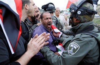 A Palestinian protester arguing with an Israeli Border Policeman near the Jewish settlement of Beit El, near Ramallah, in the West Bank, April 23, 2017.