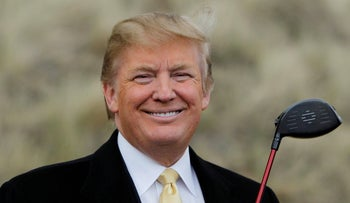 U.S. President-elect Donald Trump holds a golf club during a media event on the sand dunes of the Menie estate, the site for Trump's then-proposed golf resort, near Aberdeen, Scotland, May 27, 2010.