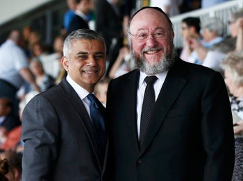 London's newly elected mayor Sadiq Khan stands with Britain's Chief Rabbi Ephraim Mirvis at a Holocaust commemoration ceremony at a rugby stadium, London, U.K., May 8, 2016.