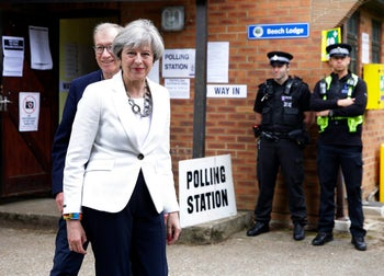 Britain's Prime Minister Theresa May leaves with her husband Philip after voting in the general election at polling station in Maidenhead, England, Thursday, June 8, 2017.