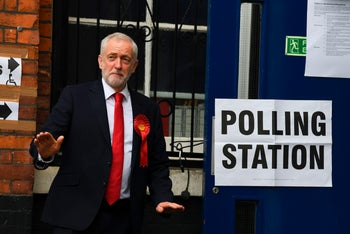 Britain's Labour party leader Jeremy Corbyn gestures as he arrives to vote in the general election at a polling station in London, Thursday, June 8, 2017.