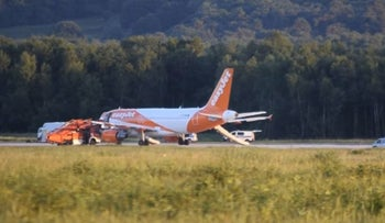 In this June 10, 2017 photo taken from a video, an easyJet  plane stands at Cologne-Bonn airport, Cologne, Germany.