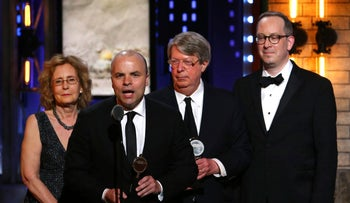 "J.T. Rogers, foreground, and the cast and crew of ""Oslo"" accept the award for best play at the 71st annual Tony Awards on Sunday, June 11, 2017, in New York."